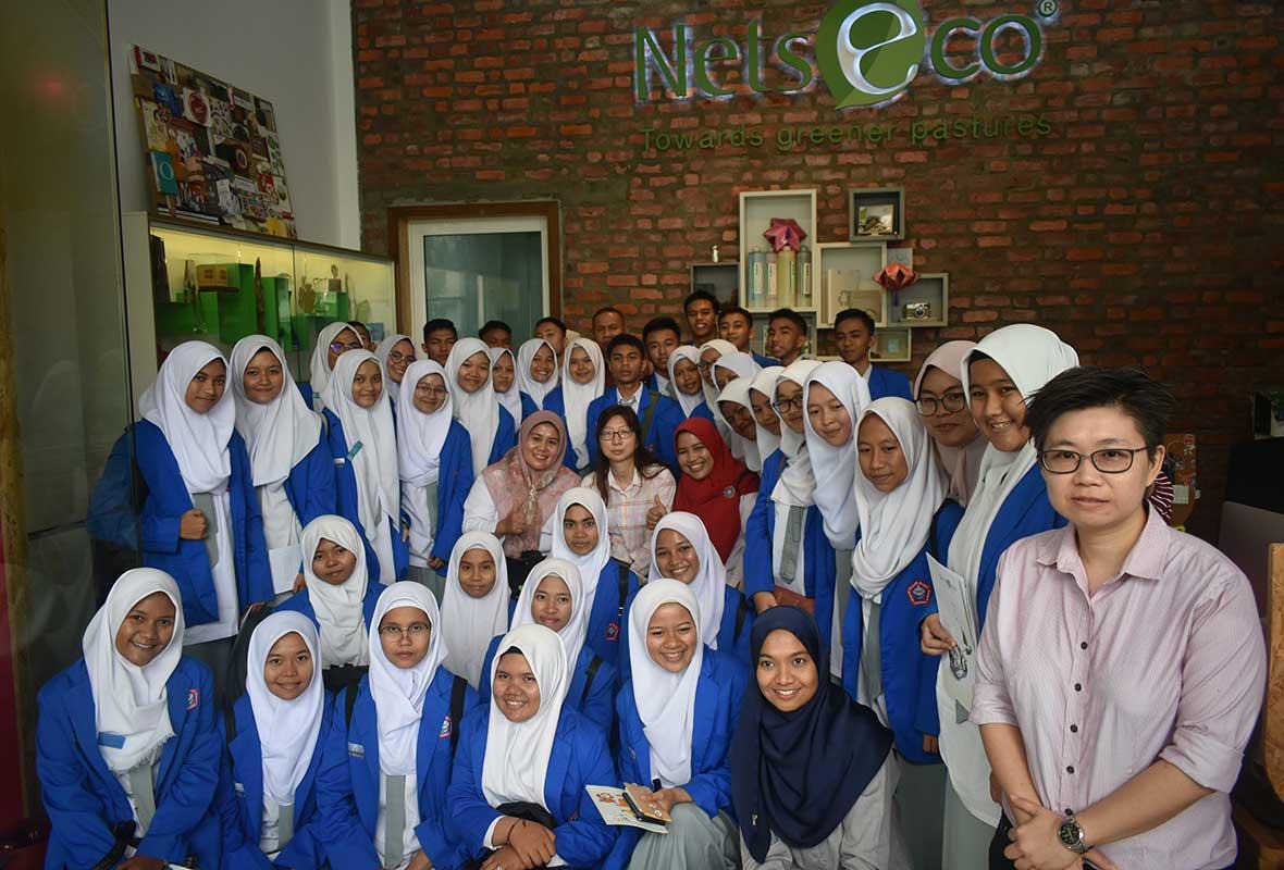 A group photo with students and teachers from Sekolah Menengah Analisis Kimia Padang, Sumatra, Indonesia.
